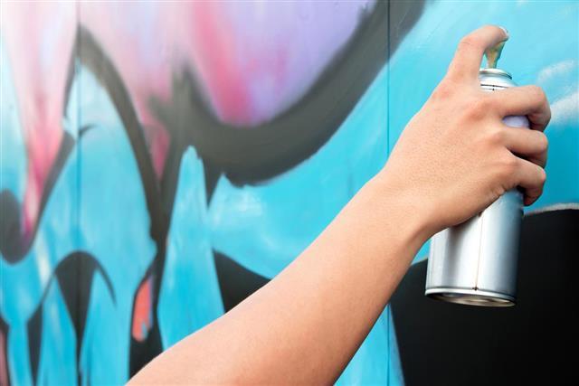Hand holding spray paint