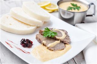 Traditional Czech & Slovak sirloin with cream sauce and dumplings