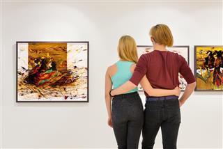 couple visit an art exhibition