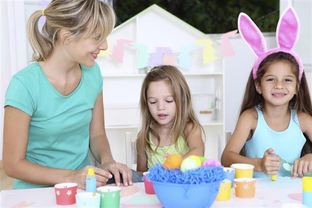 Children making decoration for Easter
