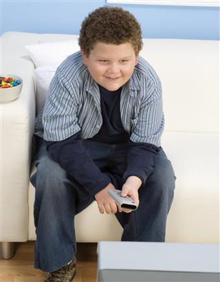Overweight Child watching tv