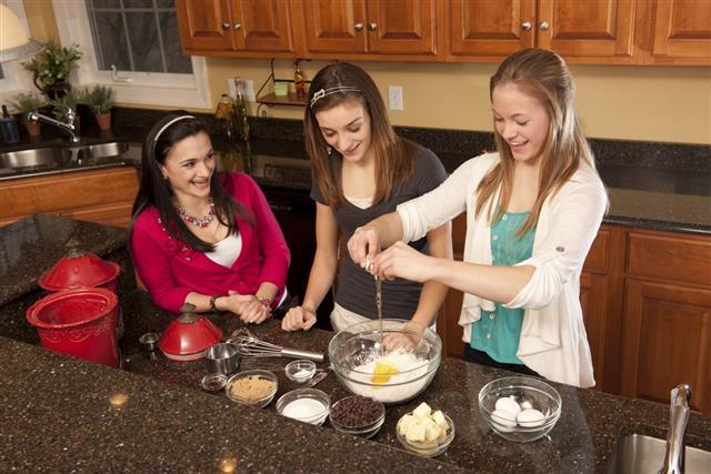 Teenager baking chocolate chip cookies