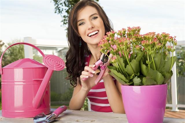 Smiling Young Woman Gardening