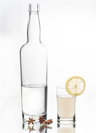 Greek Liquor Ouzo in bottle and shot glass