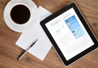 Digital Tablet PC With News On Desk