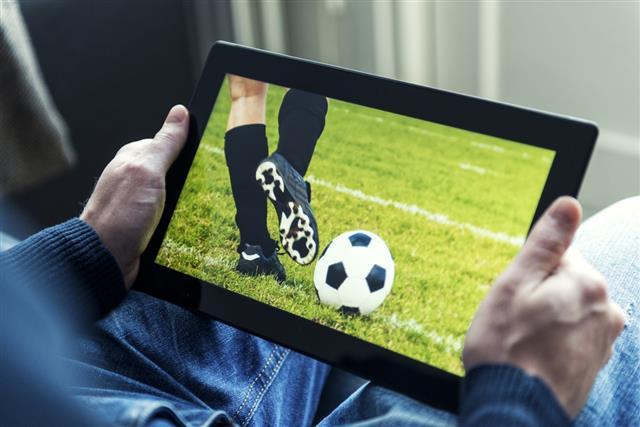Soccer match live on a digital tablet