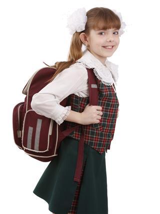 School girl with schoolbag. Education