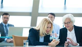 Senior businesswomen with phone