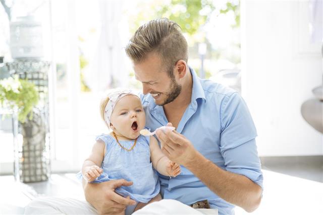 Father feeding baby