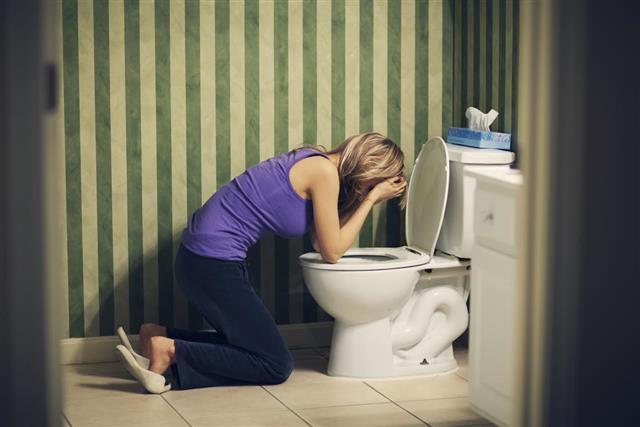 Sick woman with nausea