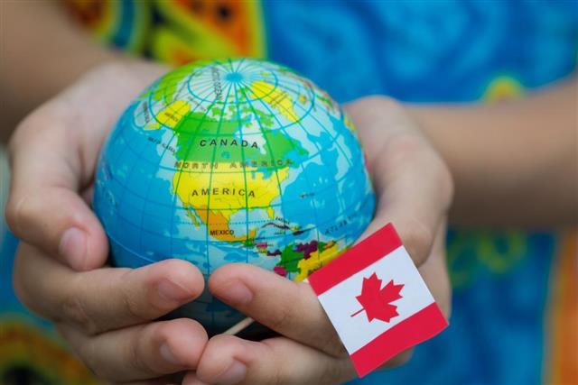 Globe and Canada flag