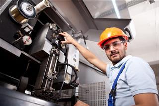 Mechanical engineer working on machine