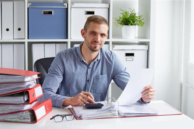 Businessman calculates taxes