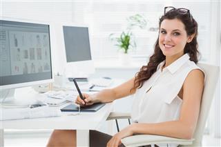 Woman using digitizer at desk