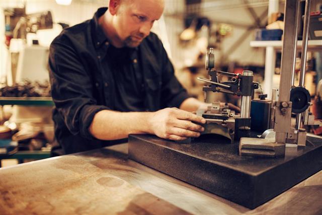 Industrial mechanic making object