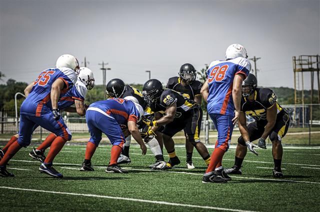 Players Playing Football