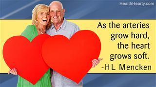 Senior Couple Holding Hearts Isolated