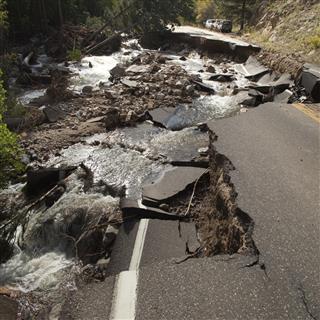 Highway destroyed Left Hand Creek flood damage Boulder Colorado