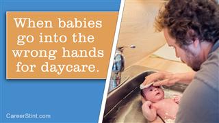 Dad Giving Bath To His Newborn Baby In Kitchen Sink