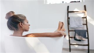 Young Woman Lying In Bathtub