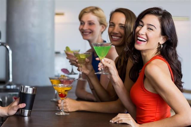 Women having cocktail