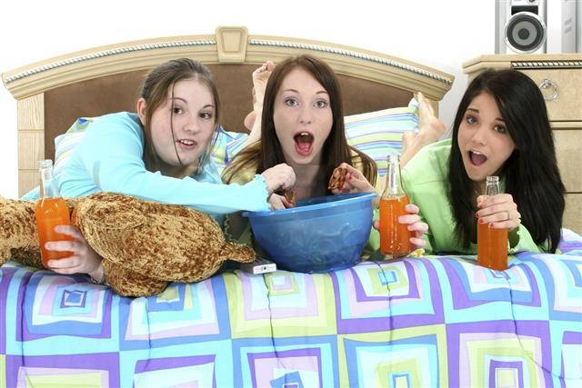 Teens Watching TV at Home
