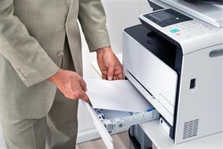 Man Using Printer In Office
