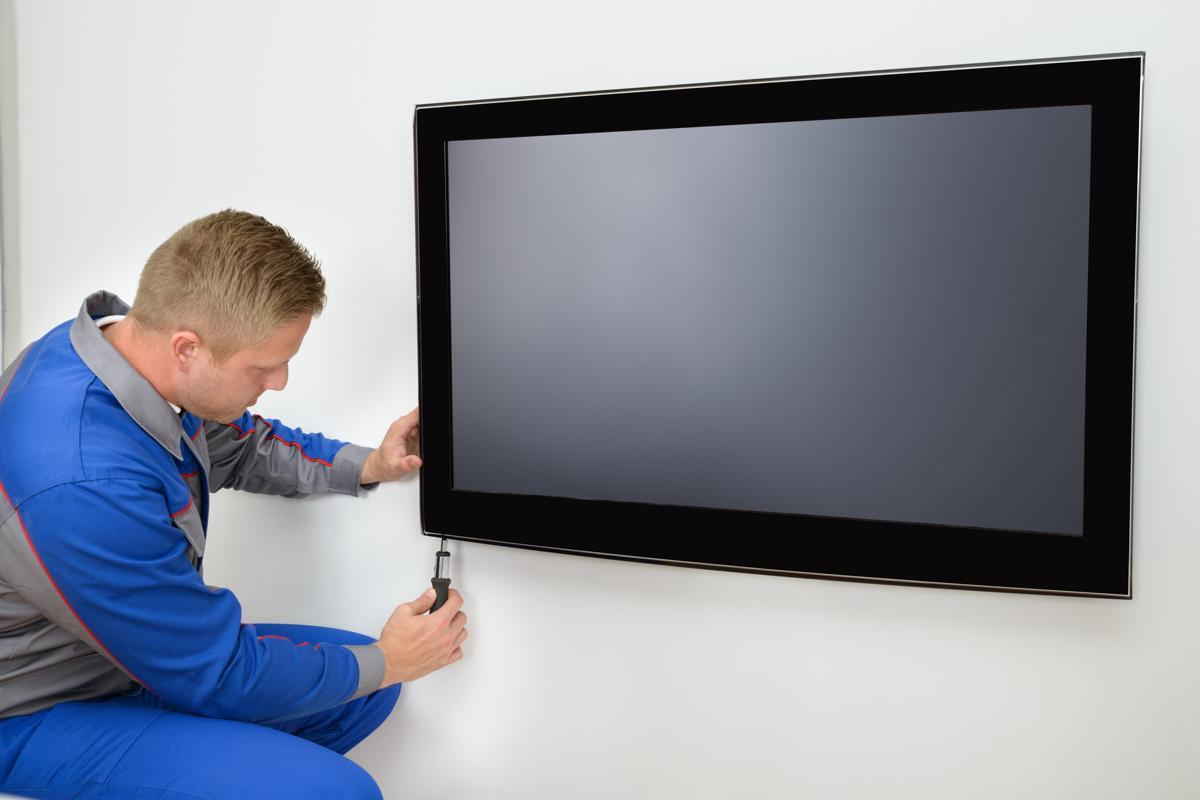 Technician repairing tv