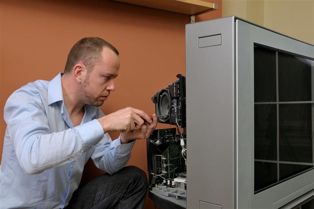 Man repairing tv