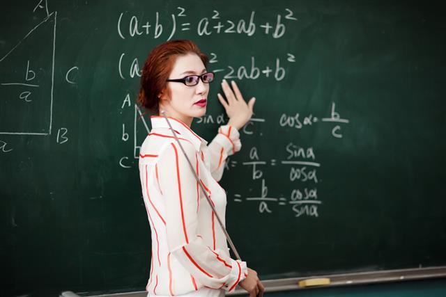 Female east Asian high school teacher in her geometry class