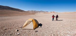 Backpacking men walking to tent