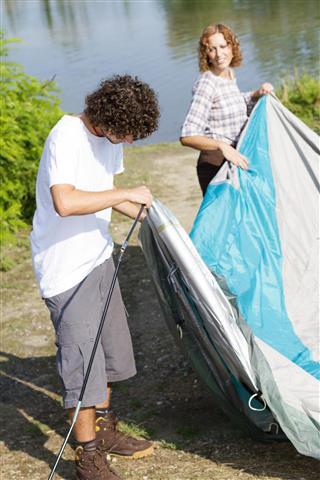 friends assembling a tent