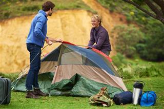 men pitching tent