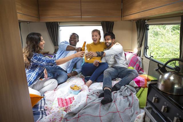 Friends Relaxing in Caravan