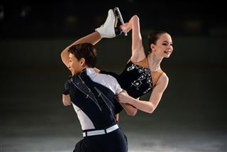 Young Figure Skating Pair Performing