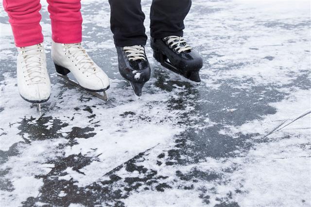 White And Black Skates On The Lake
