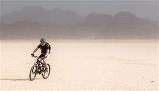 Mountain Biking On A Desert Lake