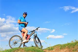 Mountain Biking On Top Of Hill