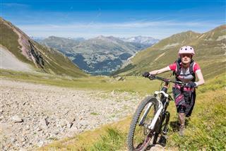 Pushing The Bike Uphill
