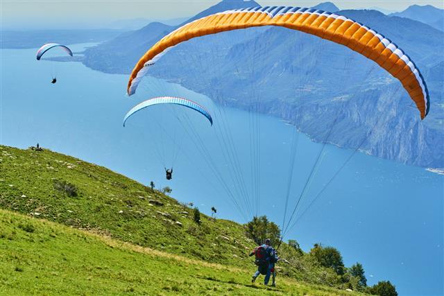 Paragliding Activity On Lake Garda