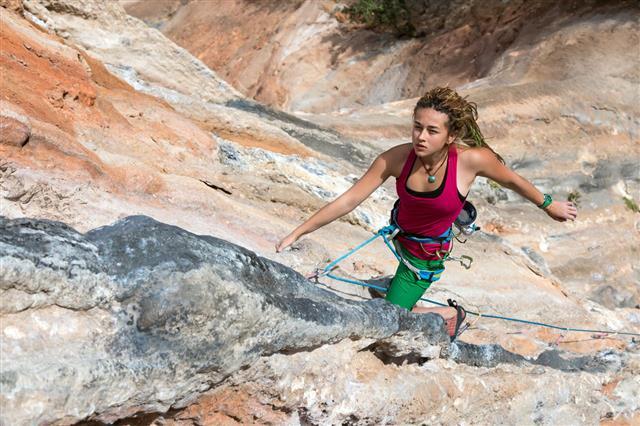 Portrait Of Cute Girl Rock Climber