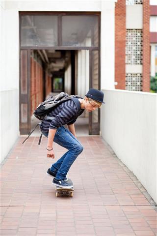 boy skateboarding in school