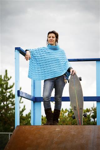 Woman Standing On Skateboard Ramp