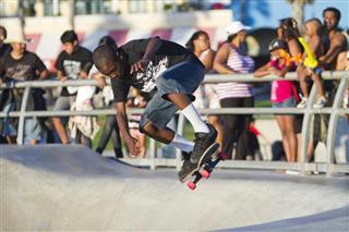 Black man skateboarding