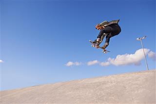 skateboarding in air