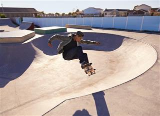 boy doing skateboarding stunt
