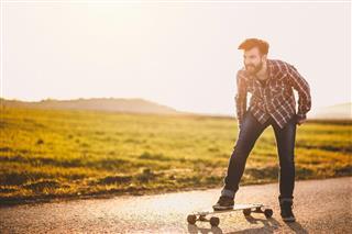 Cheerful skater on street