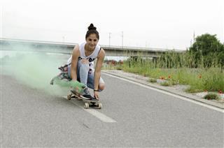 woman driving skateboard
