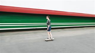 Girl riding longboard