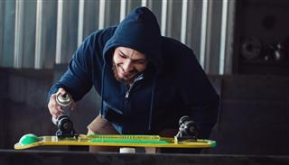 man making skateboard